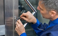 locksmith, fitter opening a door